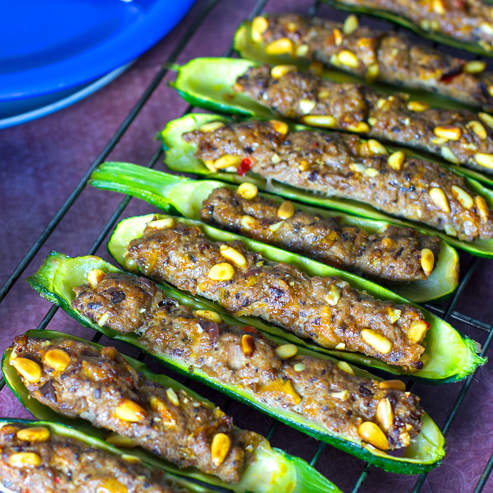 Lamb Stuffed Zucchini Boats With Romesco Sauce Eat Drink Paleo