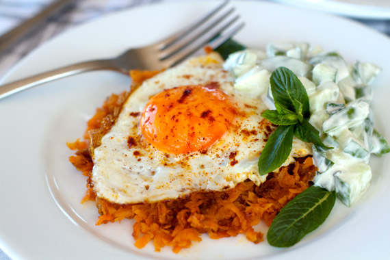 Healthy Breakfast of Sweet Potato Rosti With Fried Egg & Cucumber Tahini Raita