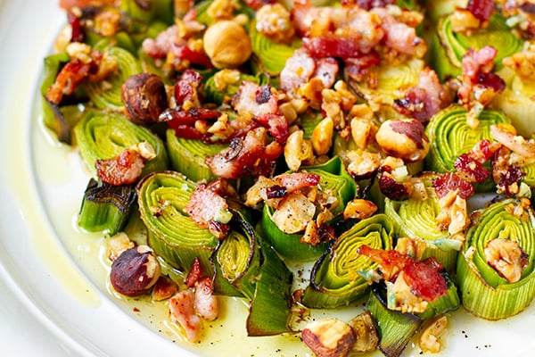 Roasted leeks with bacon and hazelnut dressing