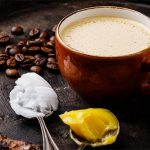 Homemade bulletproof coffee with coconut oil and ghee or butter