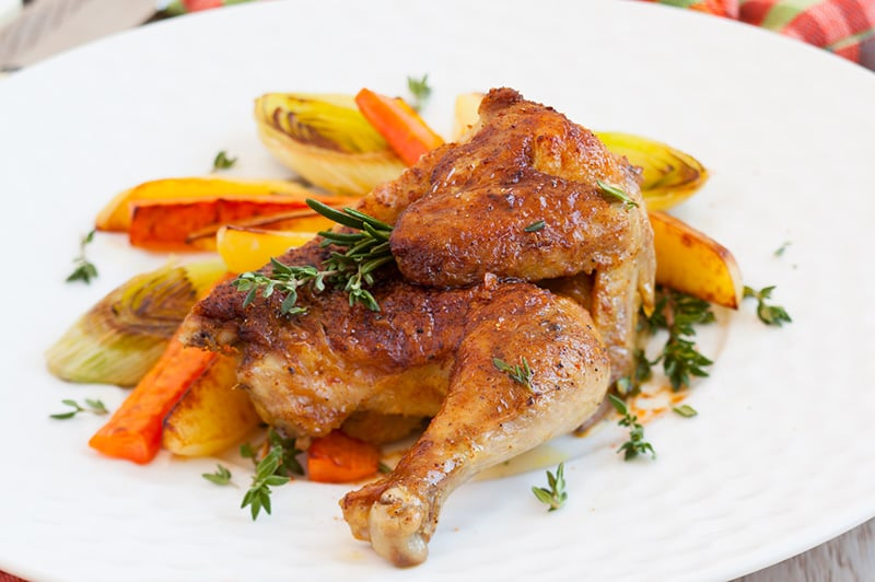 Roasted spatchcock chicken with vegetables