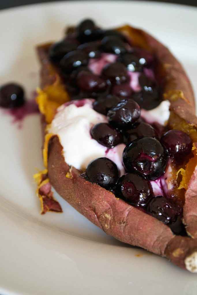 Baked sweet potato with coconut yogurt and blueberries by Comfort Bites