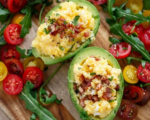 Scrambled eggs and bacon stuffed avocados