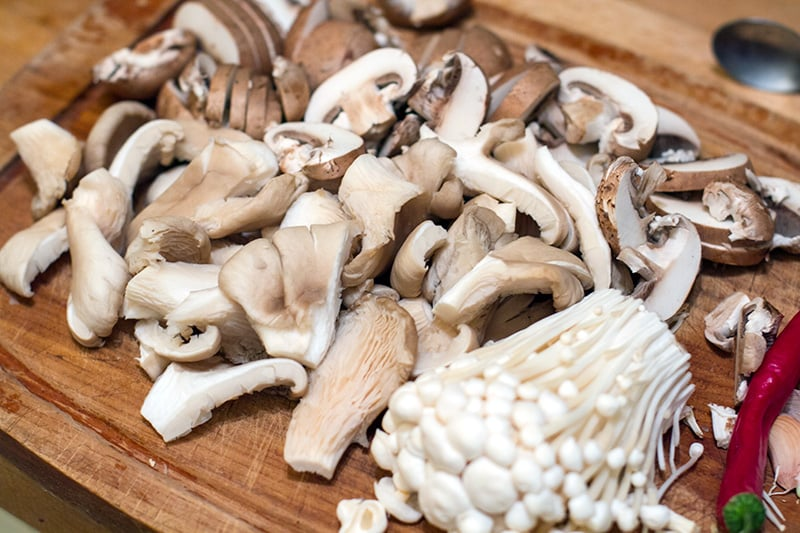 Different types of mushrooms: Swiss brown, oyster and enoki