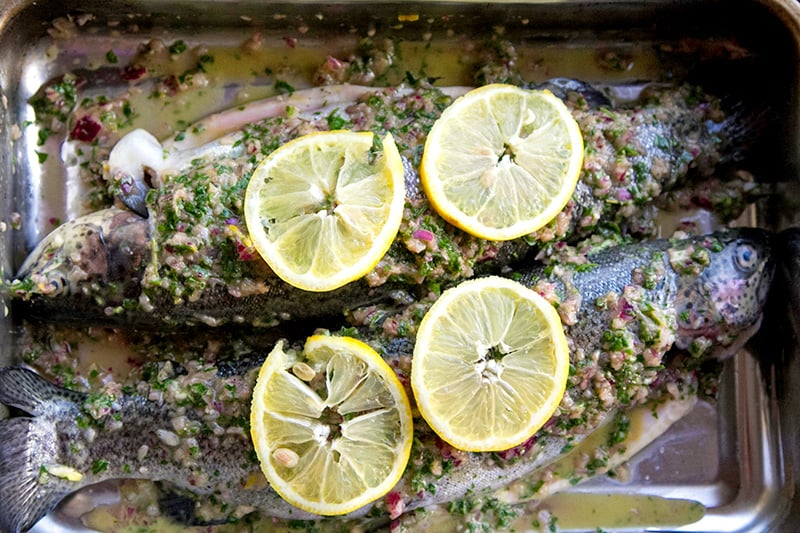 Baking whole trout with herbs and lemon