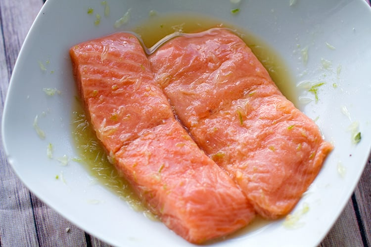 Marinating the salmon in citrus dressing