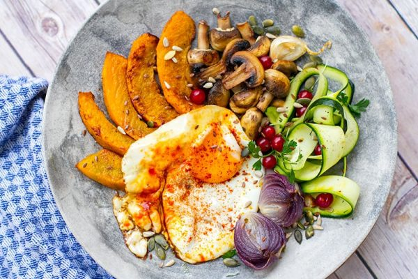 Turmeric fried egg with roasted squash and mushrooms