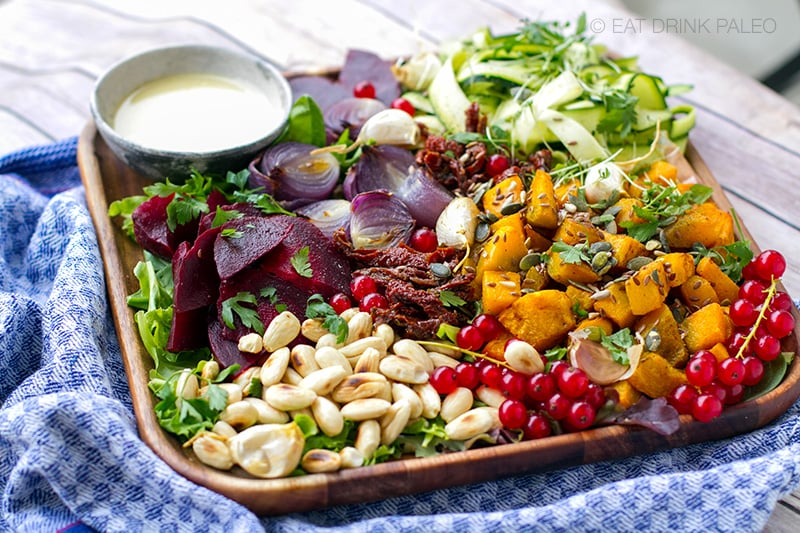 Fall salad with roasted squash and tahini garlic dressing