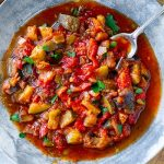 Spanish pisto vegetable stew with eggplant, zucchini, tomatoes and lots of olive oil