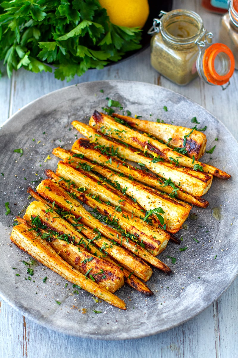 Roasted parsnips with spices, parsley and lemon