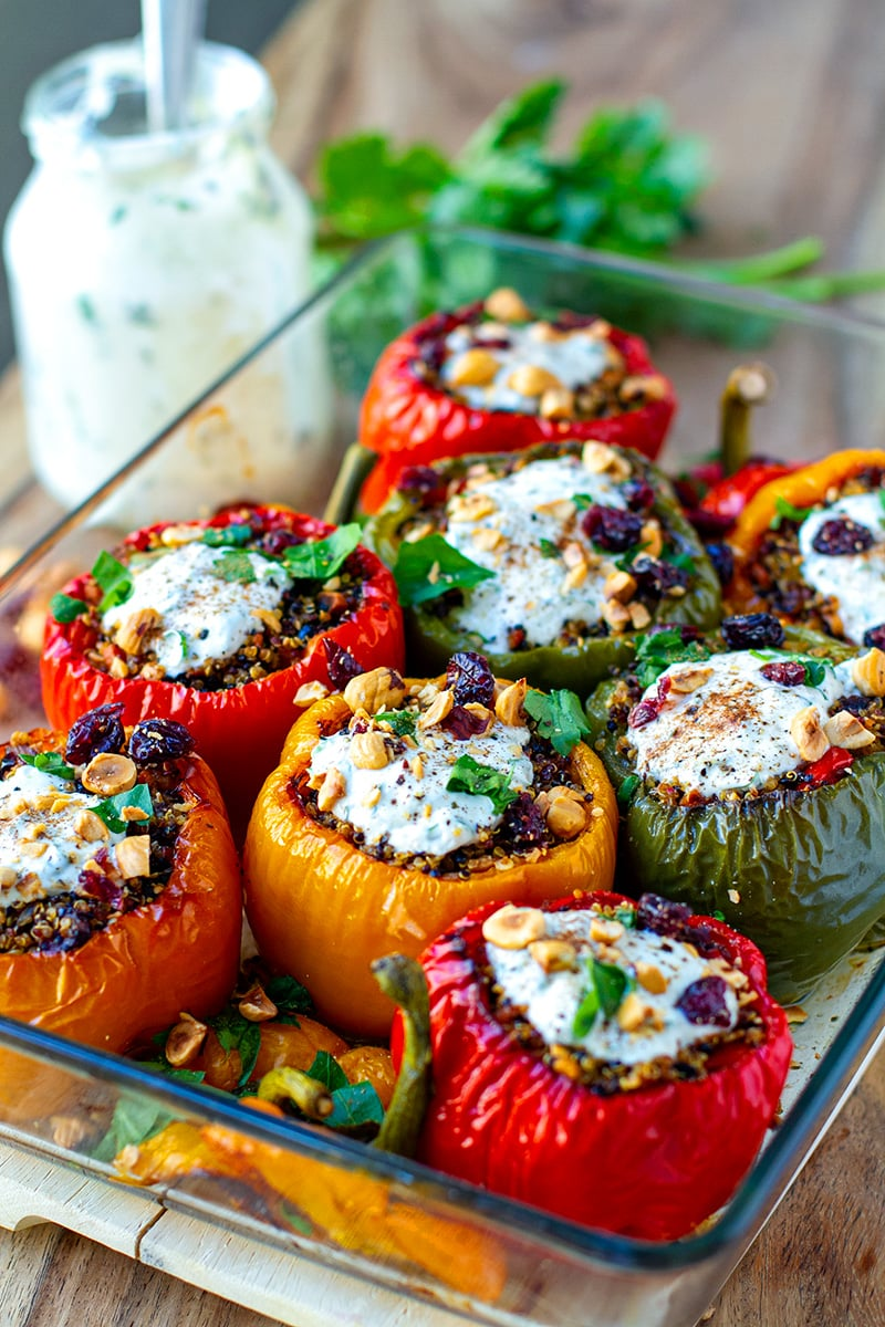 Quinoa Stuffed Peppers with hazelnuts, cranberries and garlic yoghurt ranch