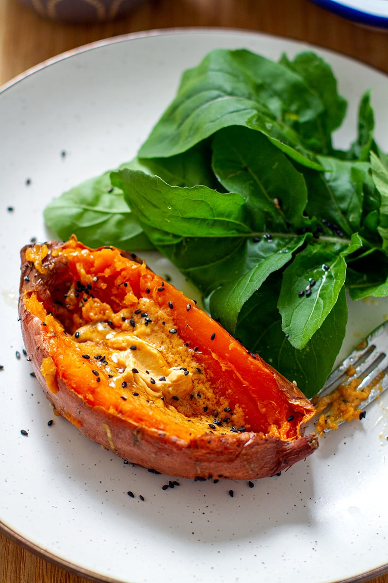 Baked sweet potato with miso butter and arugula salad