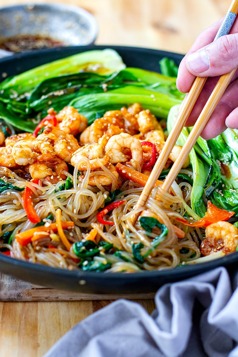 Glass noodle stir-fry with spinach, carrots, peppers and sesame sauce - Japchae