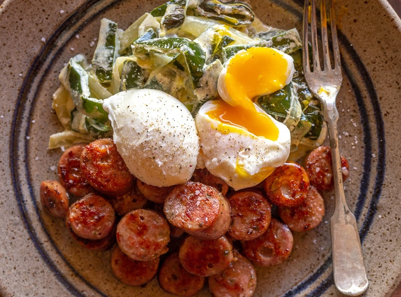 Creamy peppers with poached eggs and sausage