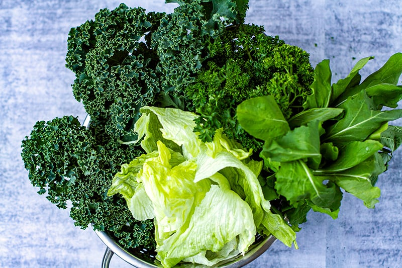 Leafy greens for a salad: kale, rocket, lettuce and parsley