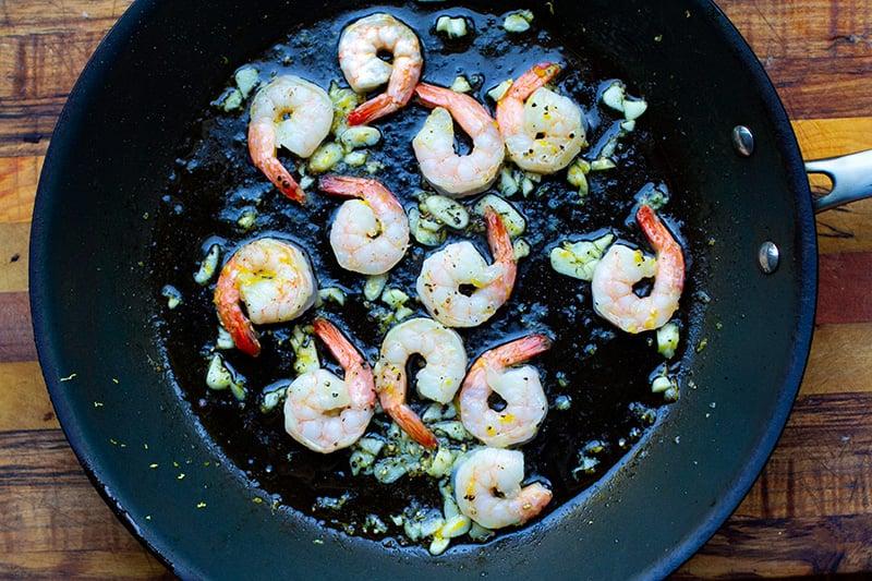 Lemon garlic shrimp in a frying pan with olive oil